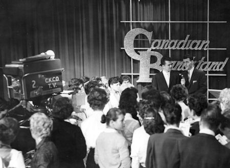 The host of Canadian Bandstand Gary McLaren interviewing guest star Conway Twitty.  In those days the guest stars would lip-sync to their hit records.