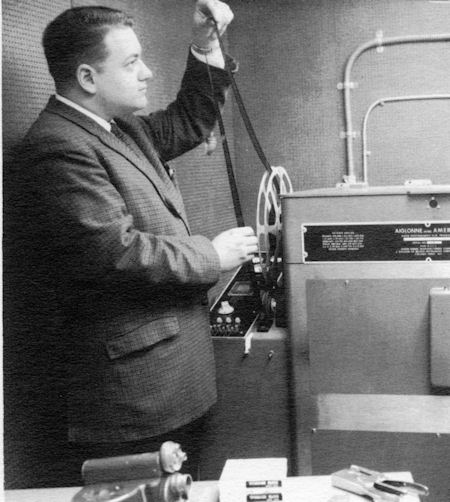 """Chief Film Cameraman Doug Lehman, shown in this promotional photo with the stations new """"state of the art"""" film processor which replaced the 3rd party processing that was previously performed by John Columbo  Film Labs"""