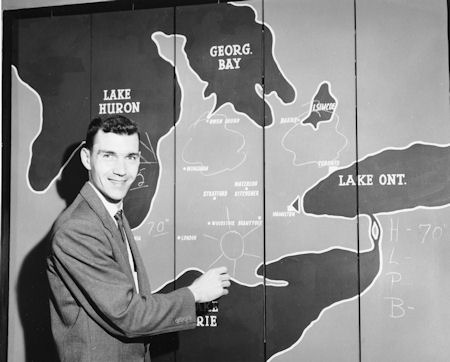 News staff in the 50s performed multiple on-air tasks.  Here's Gary McLaren doing the weather in the late 50s.  This weather board would swing on a pivot displaying the National map on reverse.