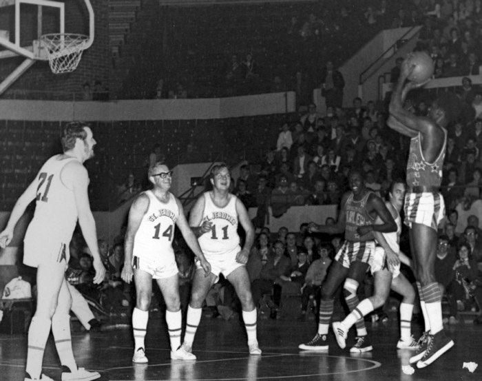 A number of CKCO TV employees participate in a media basketball game in 1969 against the famed Harlem Globe Trotters. During their 15 minutes of fame and decked out in their snappy uniforms (borrowed from The St. Jeromes High School team) they were awed by the dexterity of Meadowlark Lemon and his team mates, plainly seen in the faces of (L to R) Bill Inkol, Henning Grumme and the late Terry Thomas (caught between two Globe Trotters).  From footage filed on the game it was pointed out that the media guys touched the ball on at least three occasions.