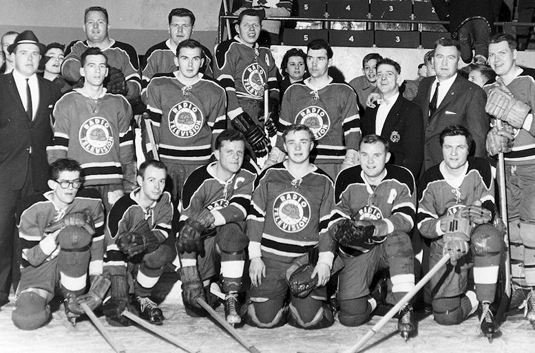 The Radio-TV All Star Hockey Team (circa late 50s)  Back: Howie Heckendorn in suit,  Doug Gerard, ???, George Moskal CKCO  Center: Joe McIntyre CKCO, Murray Davidson CKCR, Gary McLaren, Len Collis CKCO,  ???, ??? Front: ???, Don Cameron CKCR, Jim Smith, ???, Harold Zister, Gary Megaffin, CKCR Morning Man  photo courtesy of Gary McLaren