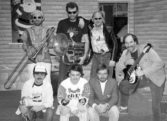 "The Warehouse Sound machine:  Clockwise Top Left: Ken Elliott, Kevin Doerr, Paul Francescutti, Pete McCallum, Brian ""Buck"" Dunseith, Jeff Hutcheson and Doug Newman. Photo from Paul Francescutti"